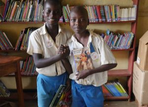 sincol-shared-reading-boys-together mbale